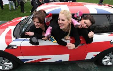 A new Mini record set as 28 gymnasts cram into one tiny car
