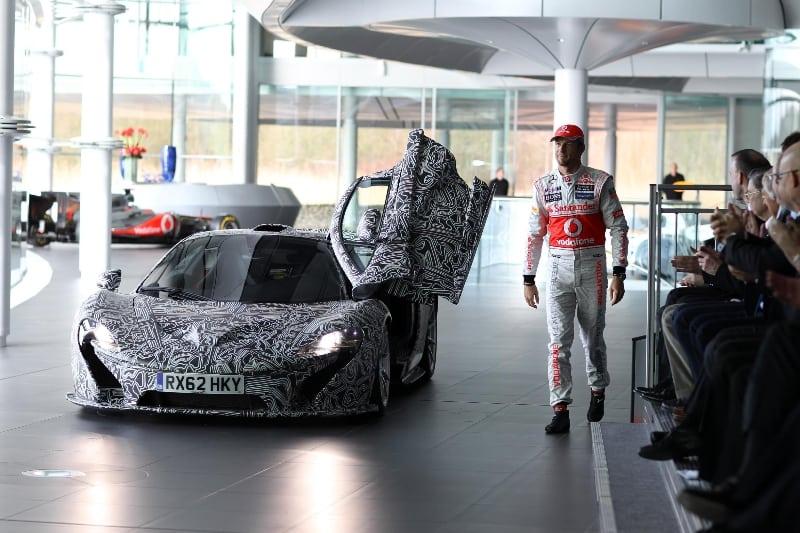 McLaren P1 makes surprise visit to MP4-28 unveil | CarNewsCafe.comCarNewsCafe.com