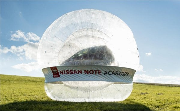 "From the ""HUH?"" Dept: Nissan Creates World's Biggest Zorb and Puts a Car In It"